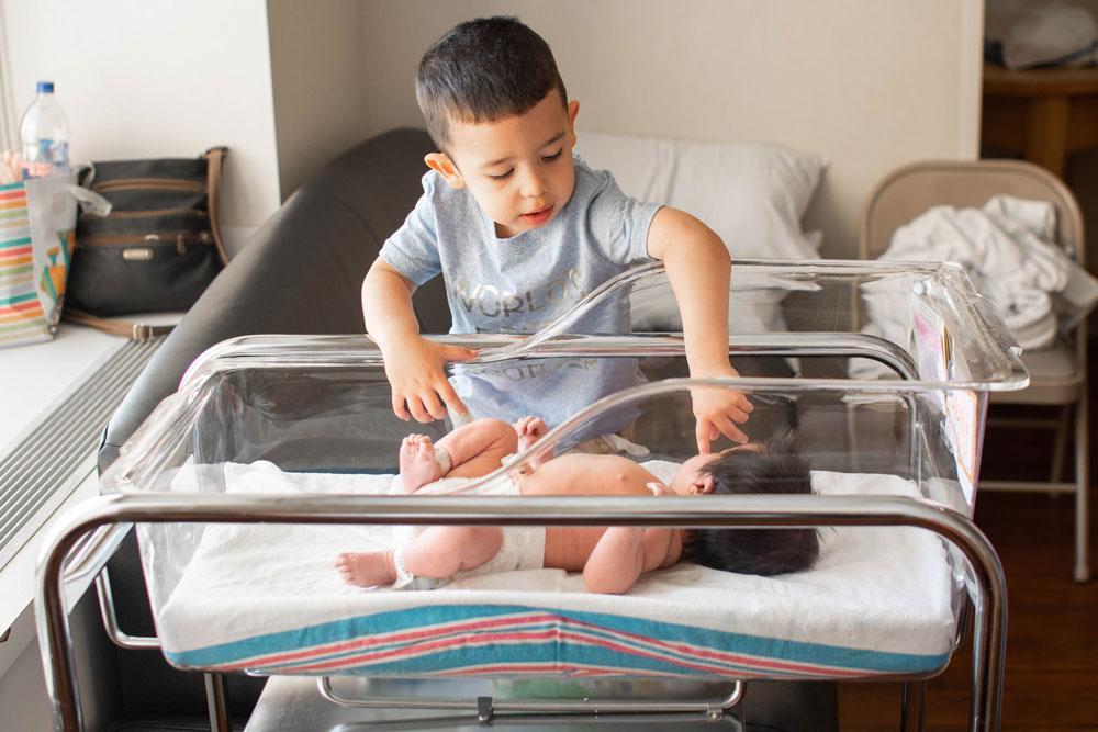 Salt Lake City Fresh 48 Photographer brother with newborn sister