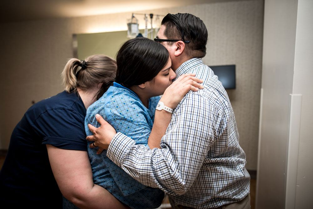 doula and dad hold mom during contractions and active labor