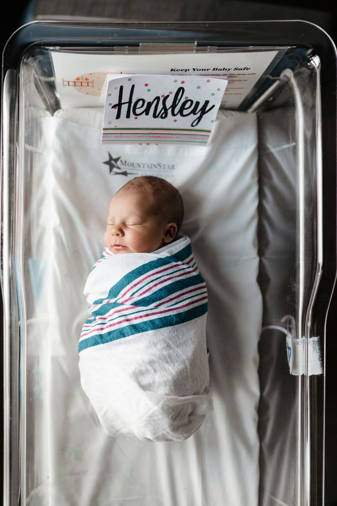 Baby girl sleeps in her bassinet during a fresh 48 photography session at the hospital