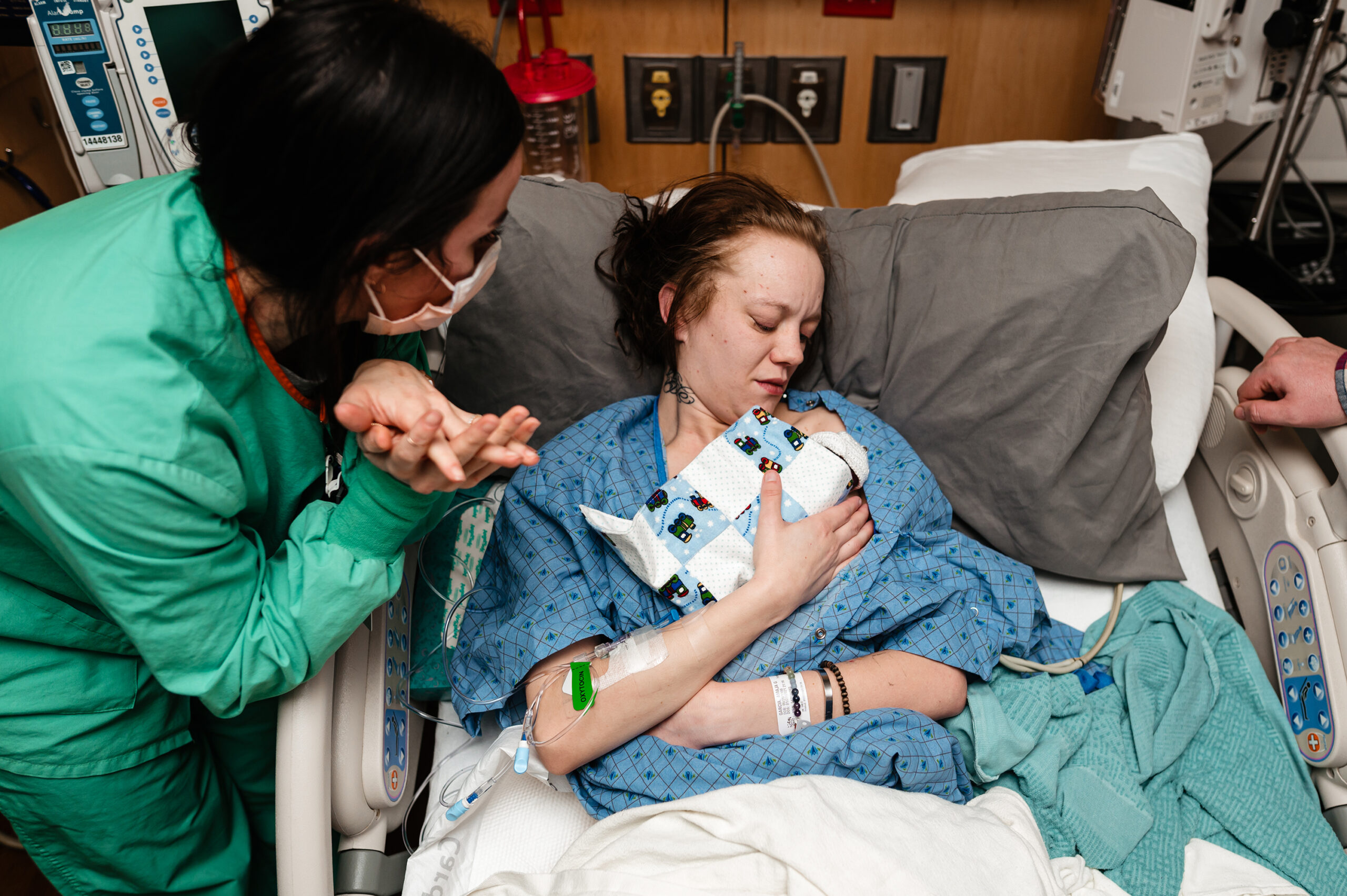 Mother holds her son who passed away at 19 weeks gestation in a hospital bed